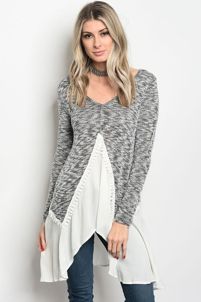 Ladies fashion long sleeve knit top that features a v neckline