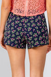 Ladies fashion navy floral print scalloped hem shorts