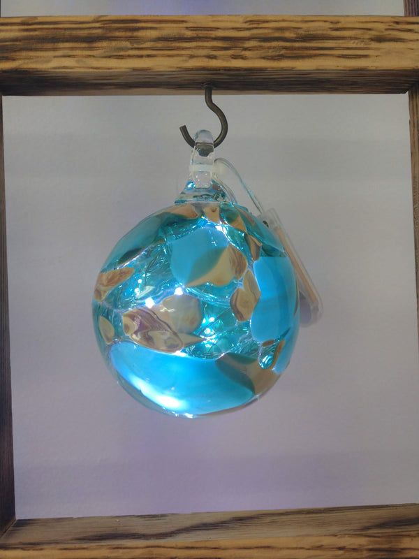 Hand blown glass memory ball Teal and Tan