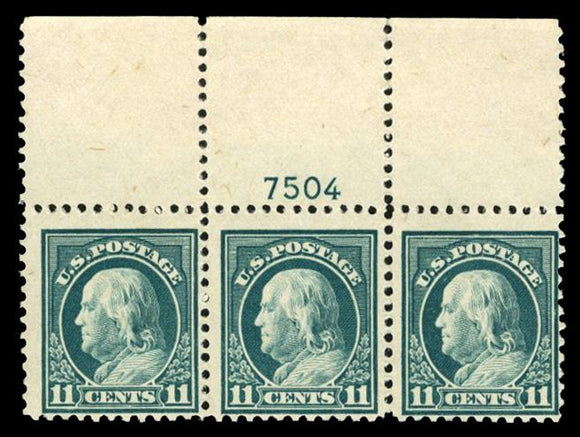 US #511 1917 11c light green, top margin horizontal strip of three with plate number, right stamp never hinged, other two lightly hinged. Cat. 511