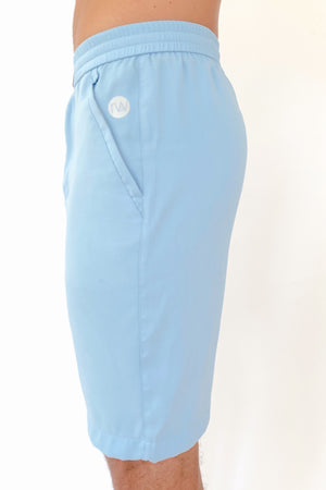 "the ""Waino"" men's shorts in blue - recovery wear clothing - side view"