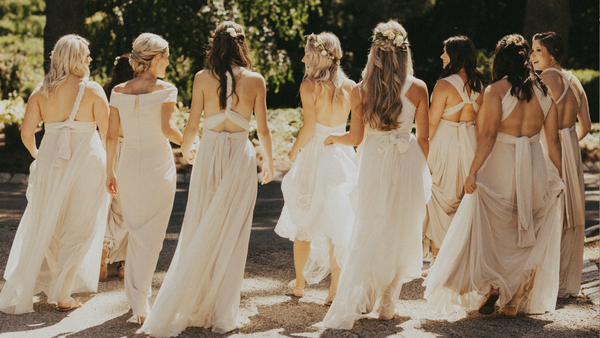 twobirds bridesmaids wearing champagne tulle ballgown