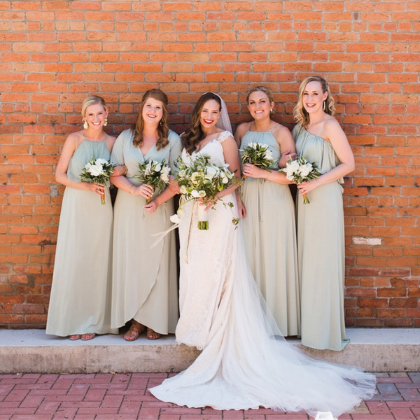 twobirds bridal party wearing sage party collection