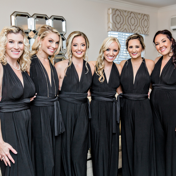 twobirds bridal party in black convertible jumpsuits