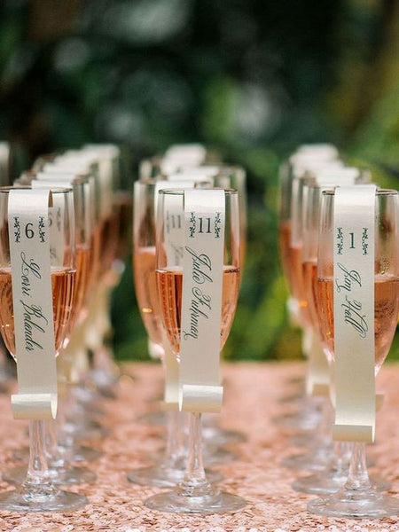 Glass of champagne to be used as escort card