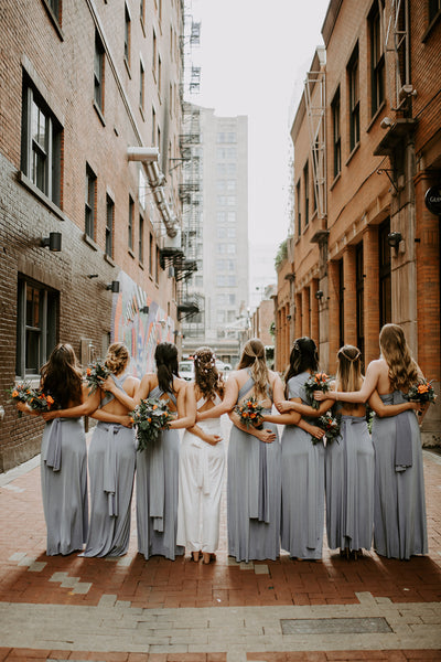 twobirds bridesmaid wearing dusty blue slit dress