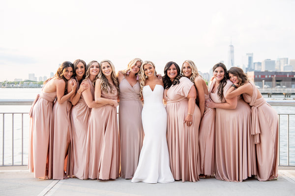 twobirds bridal party wearing blush ballgown