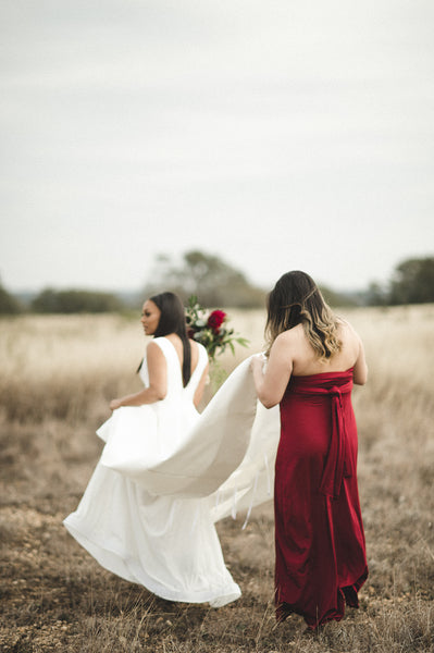 twobirds bridesmaid wearing burgundy ballgown in the strapless style