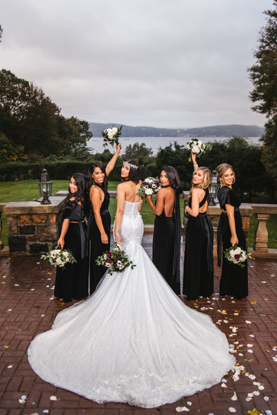twobirds bridal party wearing black velvet jumpsuits