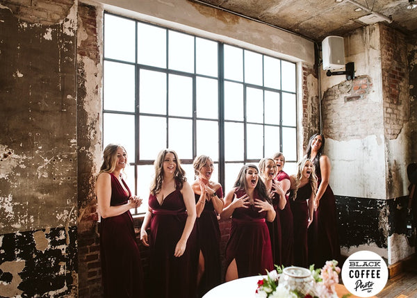 bride doing first looks with her bridesmaids