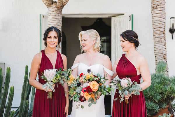 twobirds bridal party in burgundy ballgowns