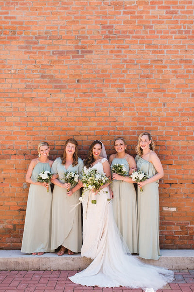 twobirds bridal party wearing the Sage Party Collection