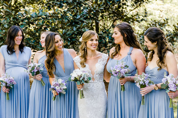 twobirds bridal party wearing color light blue