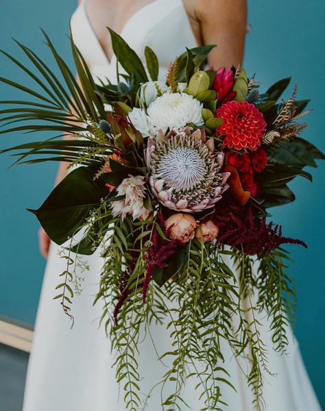 wedding bouquet with turquoise backdrop