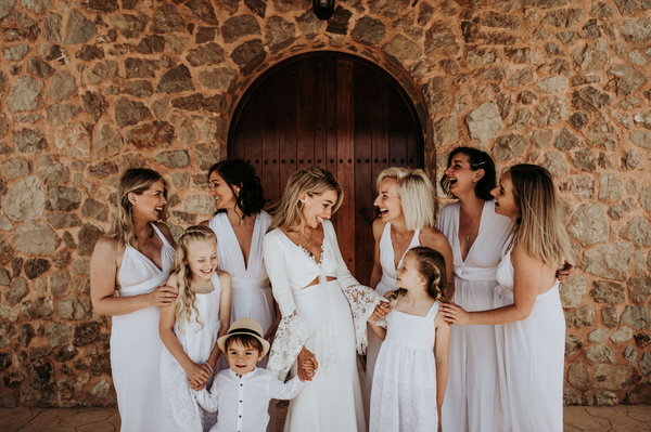twobirds bridesmaids wearing ivory jumpsuits