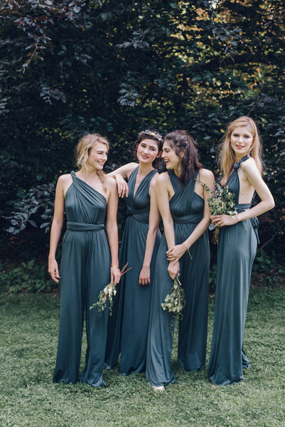 twobirds bridesmaid showing off the knotted tank style