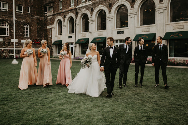twobirds bridesmaids wearing peach, blush and rosewood