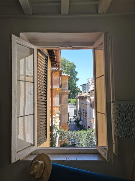 Looking through a window onto a street in Italy