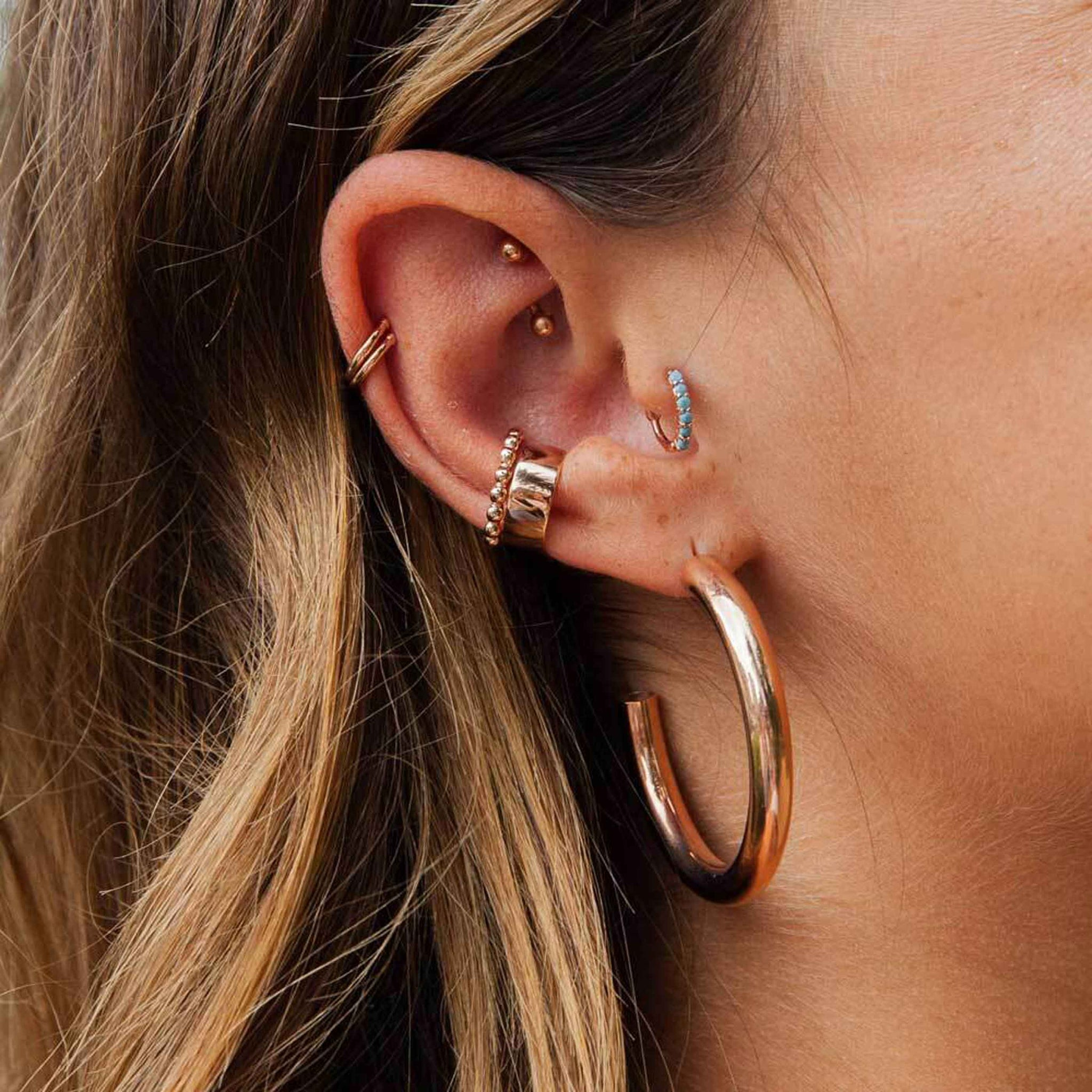 Basic Large Hoop Earrings in Rose Gold worn with ear cuffs