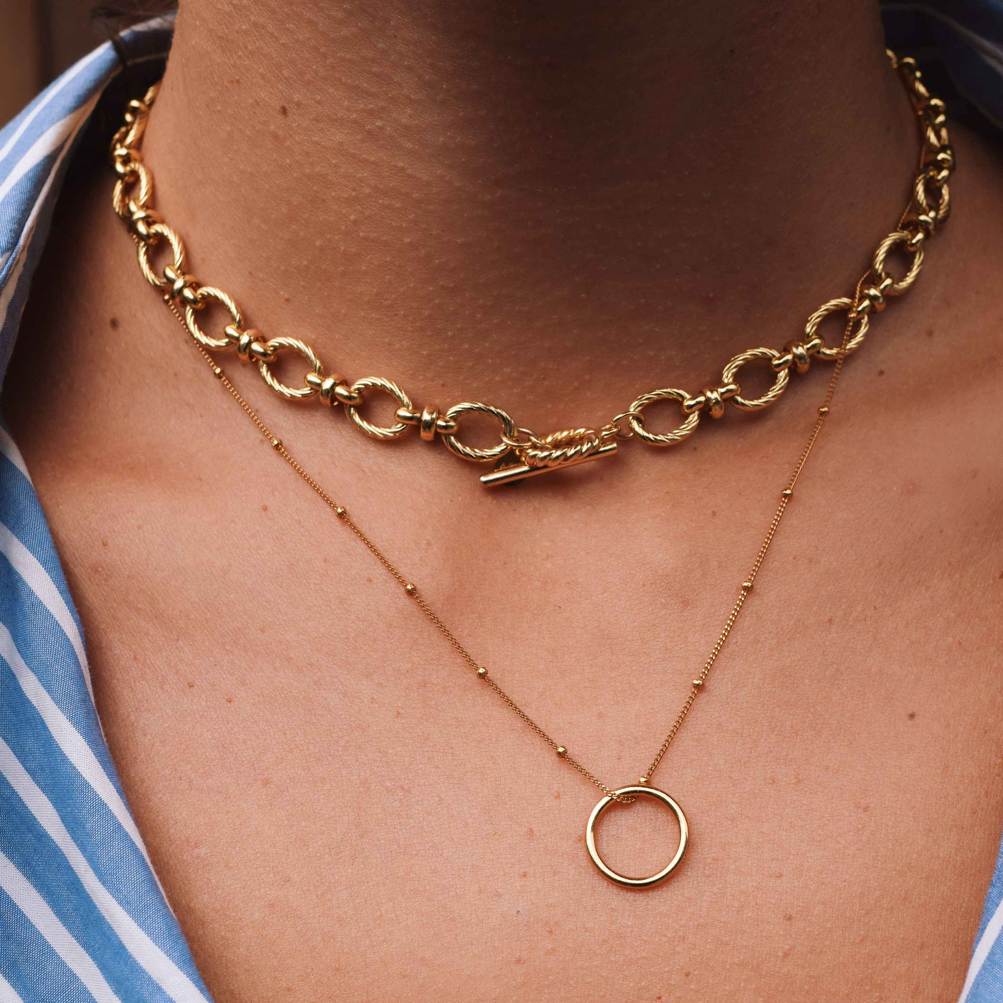 Basic Halo Pendant Necklace in Gold worn with chunky vintage chain