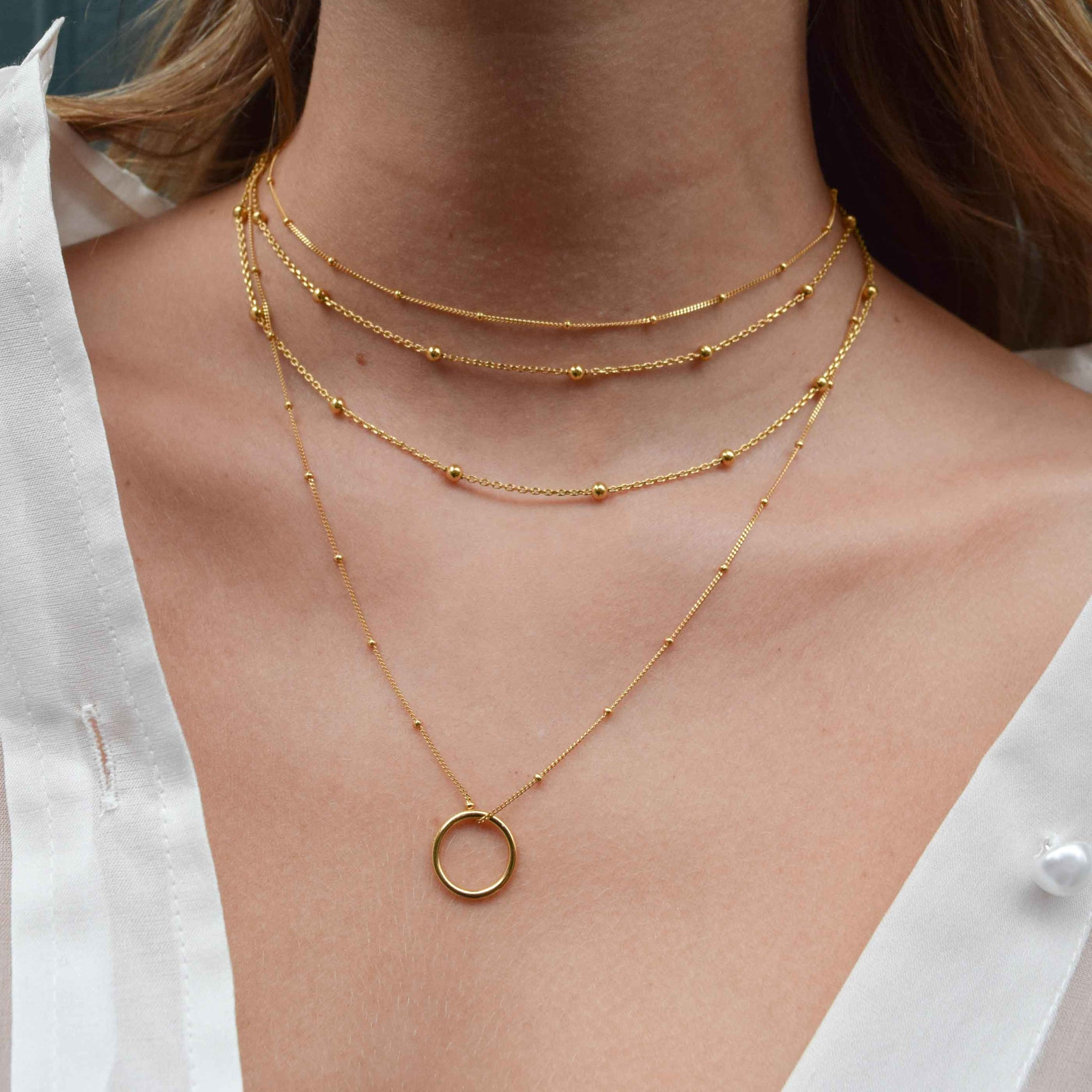 Basic Halo Pendant Necklace in Gold worn with beaded chokers