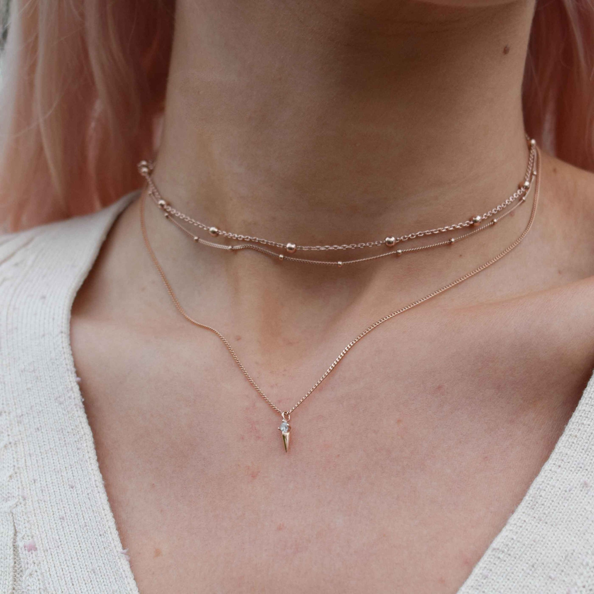 Basic Small Beaded Choker in Rose Gold worn with pendant necklace