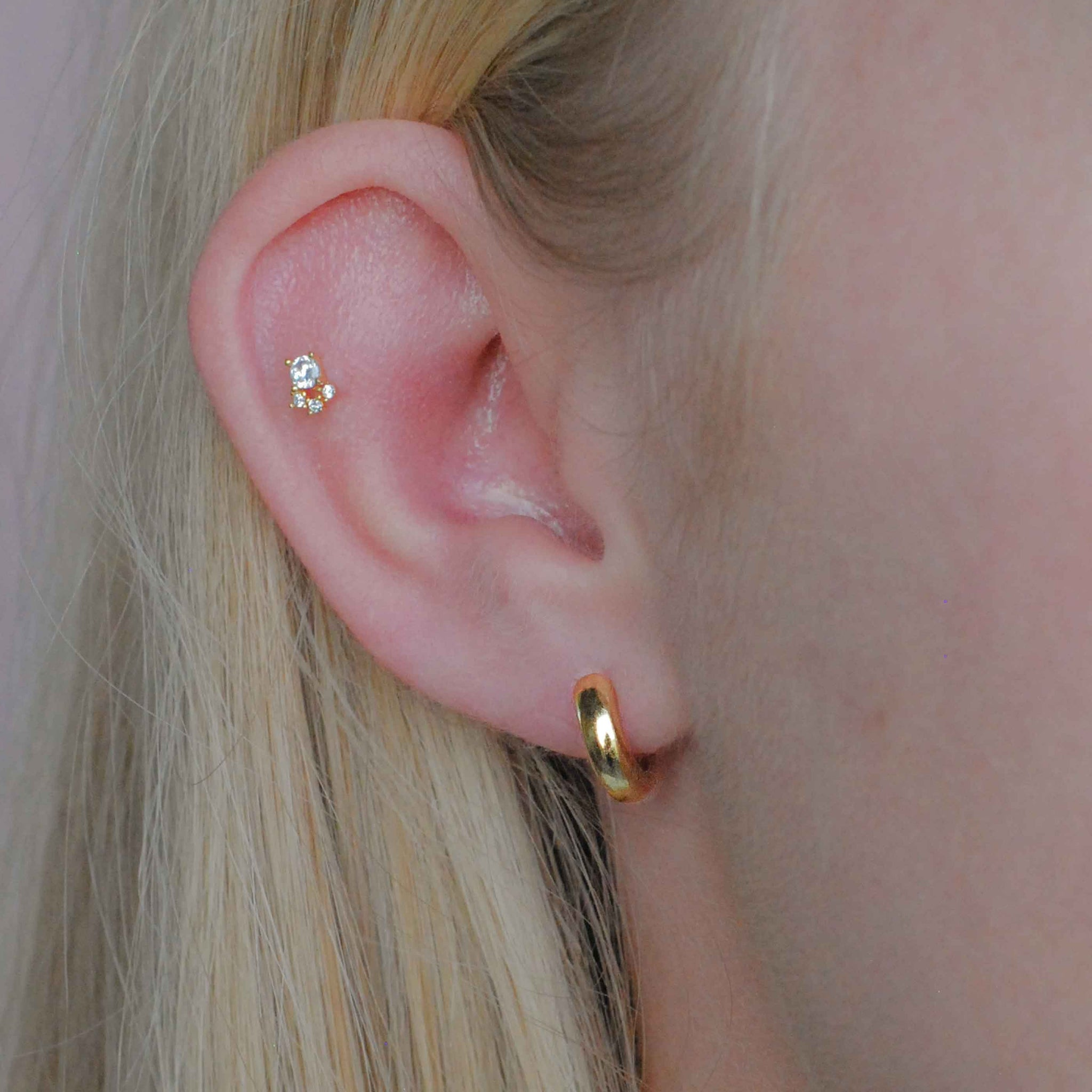 Crystal & Triple Stone Barbell in Gold worn in outer conch piercing