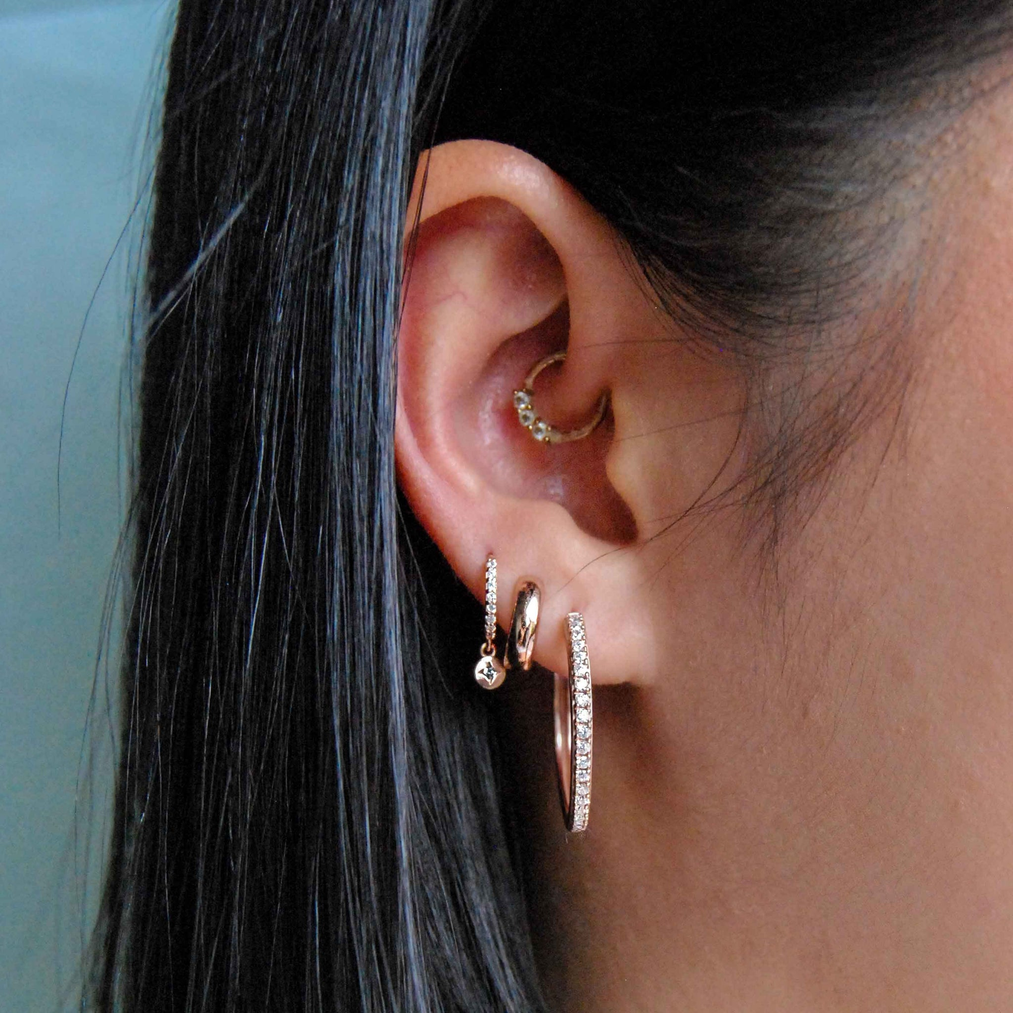 Bold Huggies in Rose Gold worn in second lobe piercing