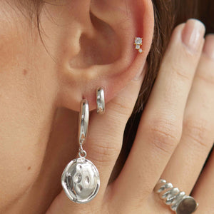 Bold Huggies in Silver worn in second lobe with chunky hoops