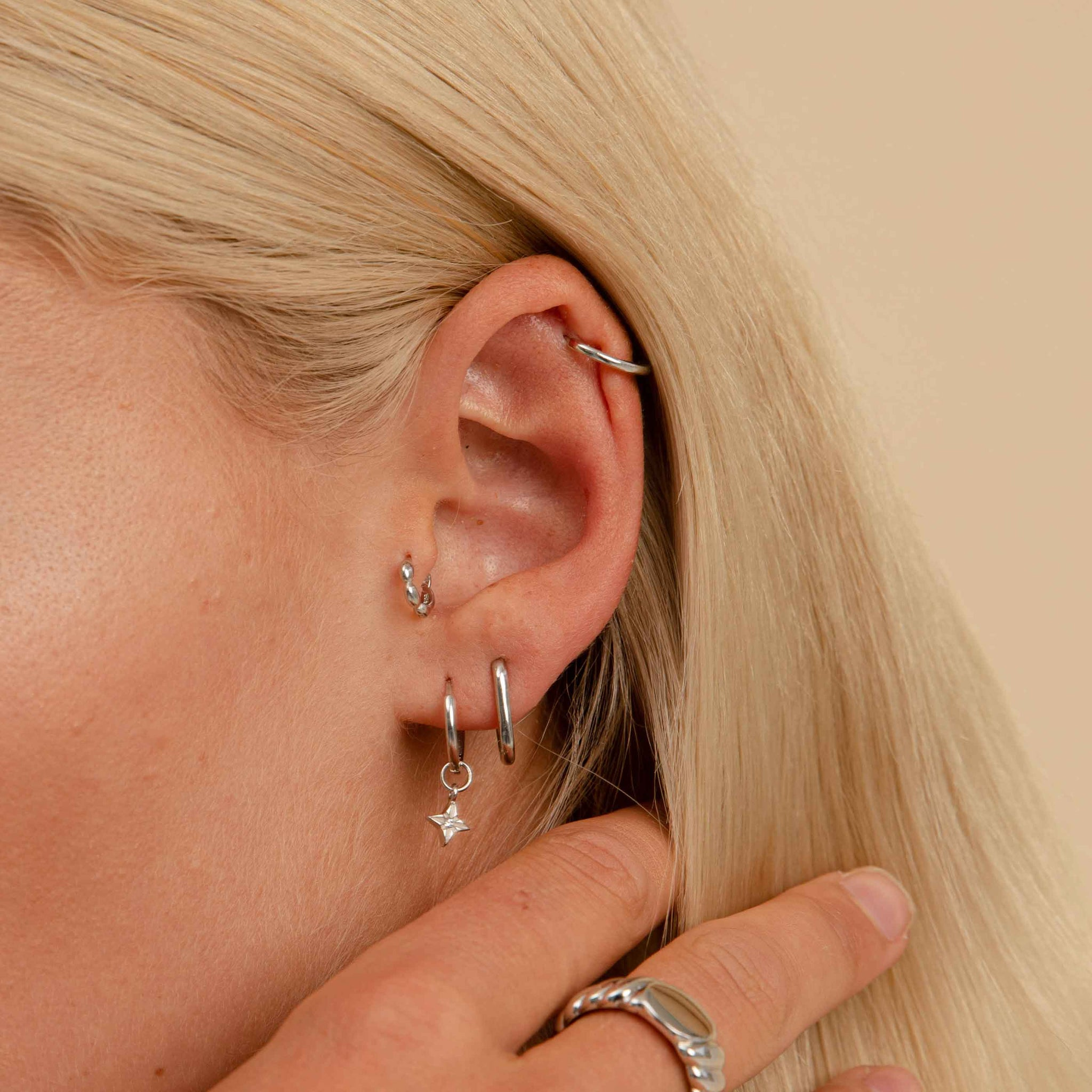 Bubble Clicker in Silver in tragus piercing