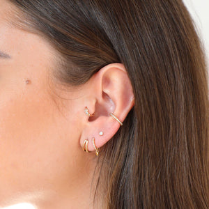 gold jewelled clicker worn in tragus piercing