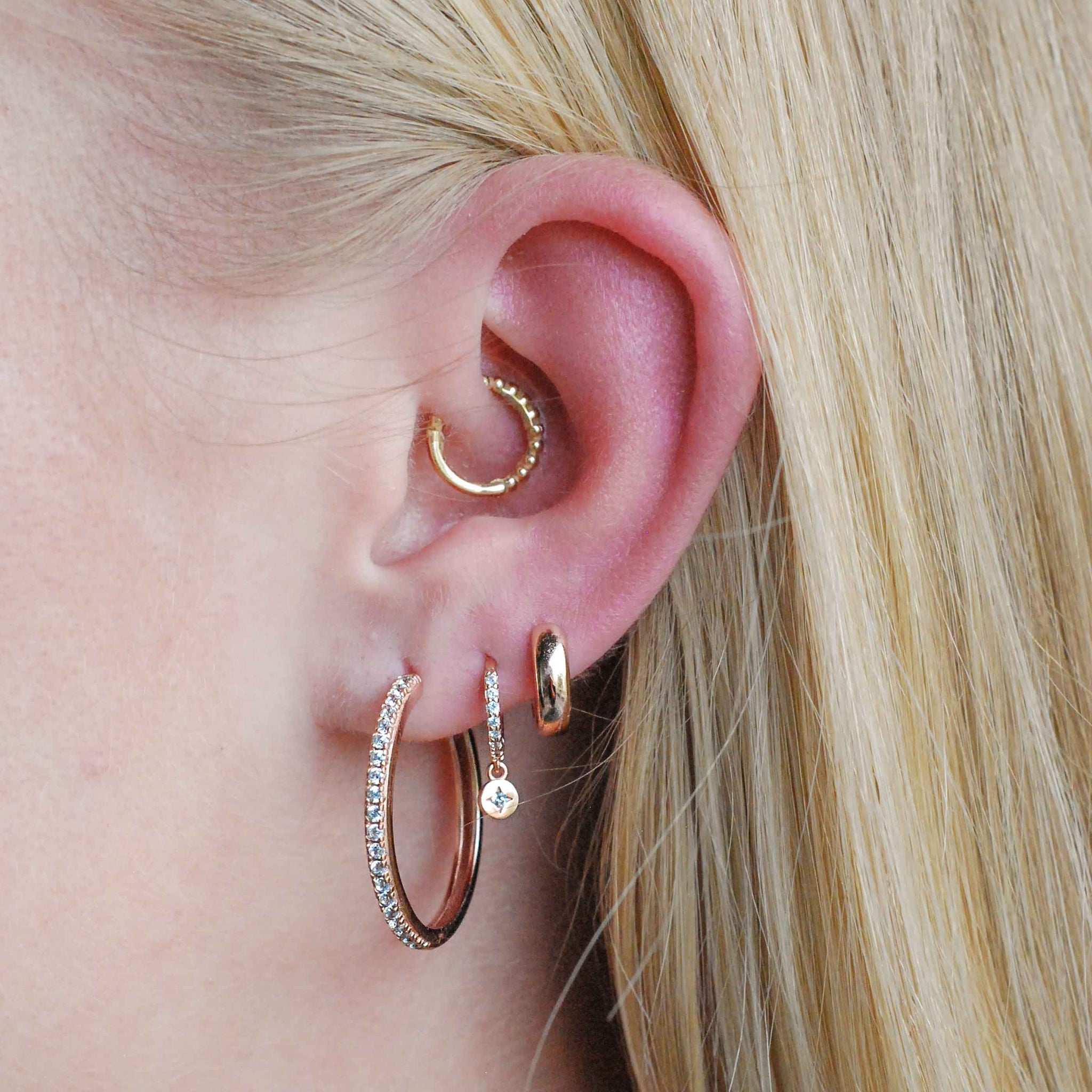 Crystal Hinge Hoops in Rose Gold worn with huggies