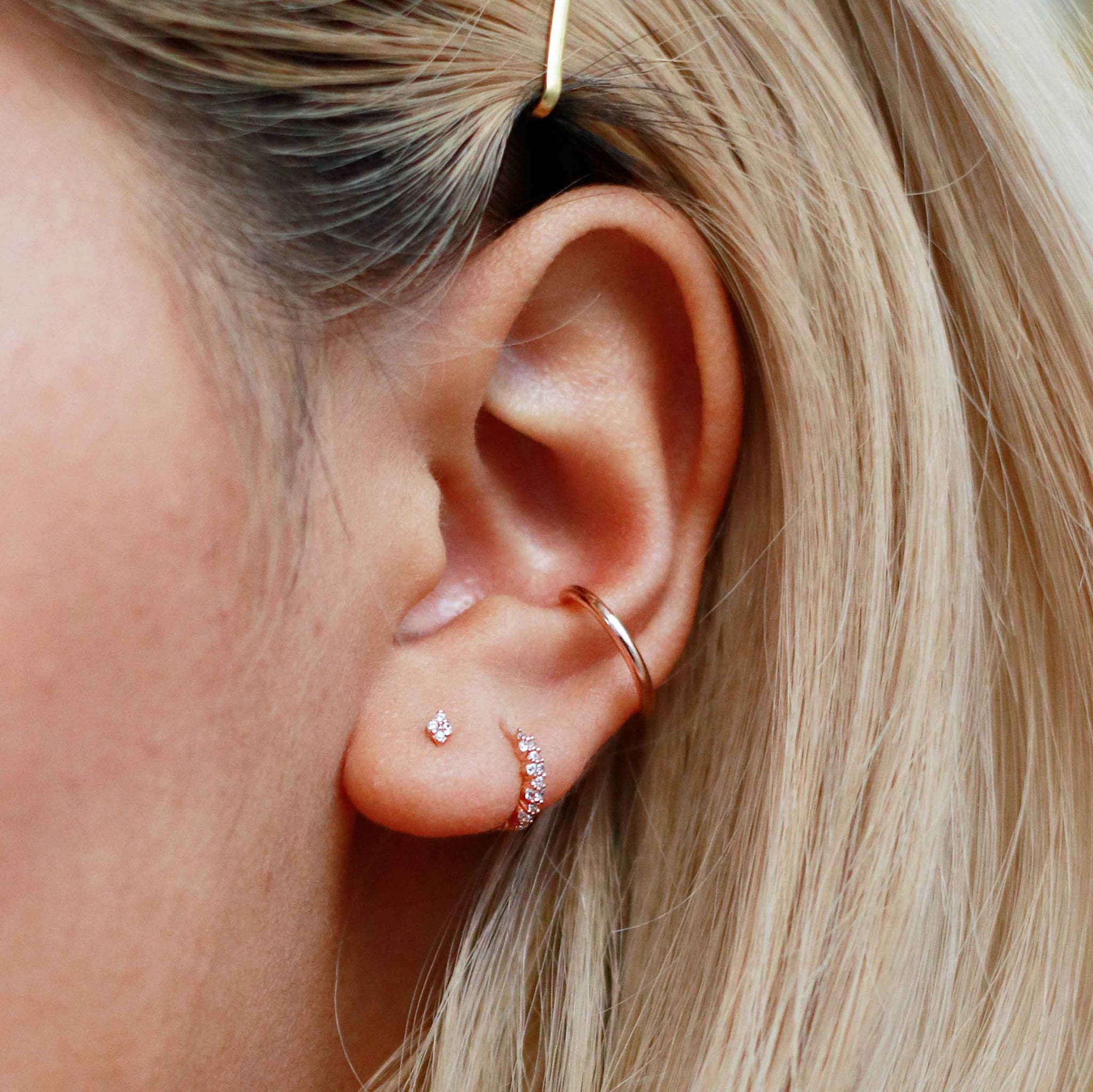 Dainty Crystal Clicker in Rose Gold worn in second lobe piercing