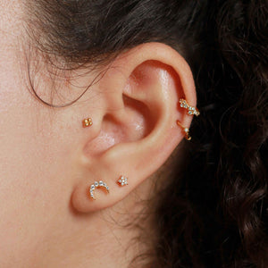 Dainty Crystal Clicker in Gold worn in cartilage piercing