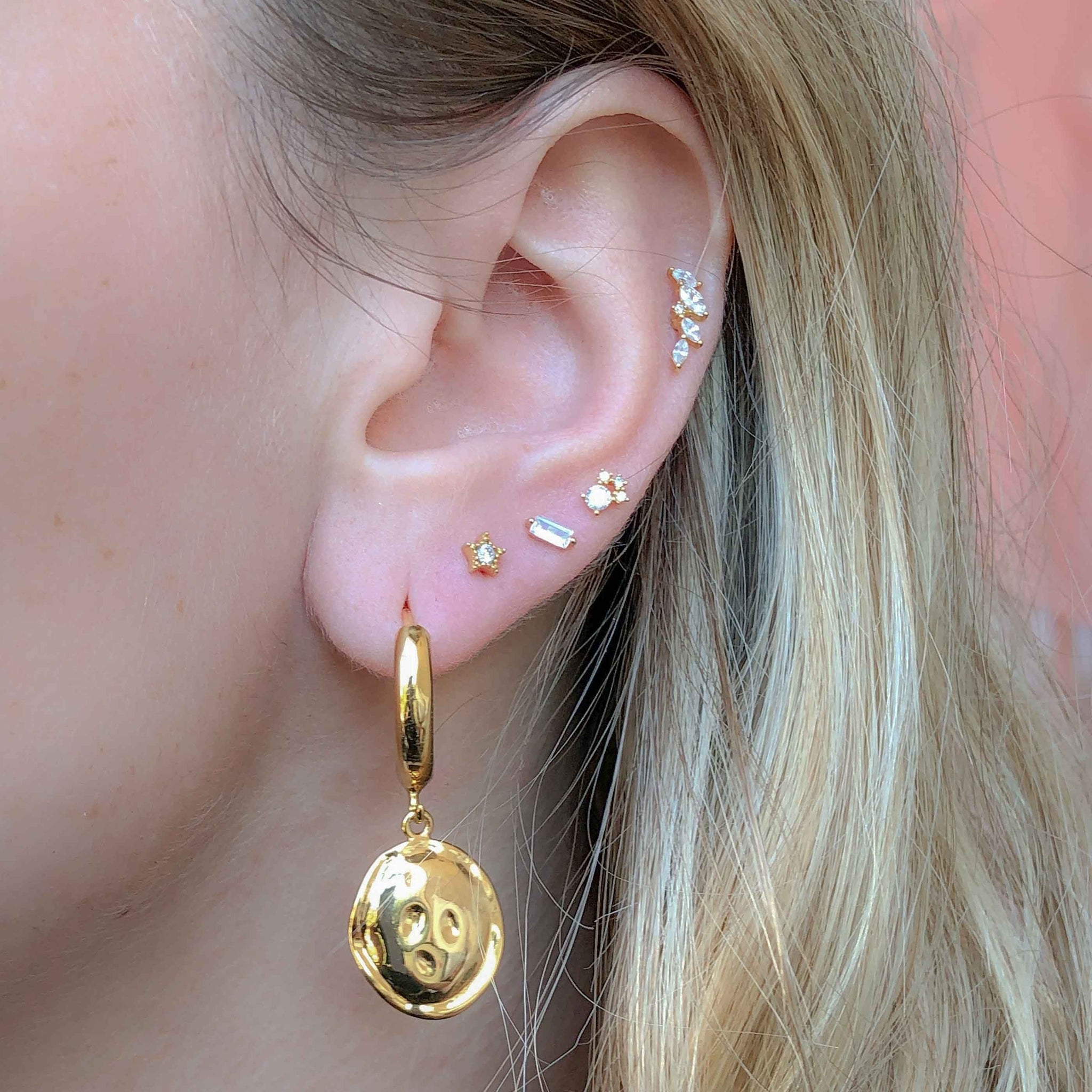 Crystal & Triple Stone Barbell in Gold worn in upper lobe piercing