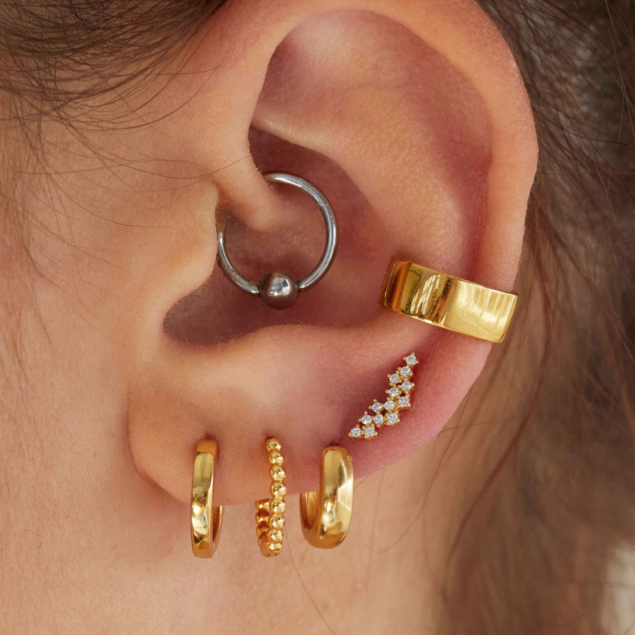 Jewelled Barbell in Gold worn with hoops