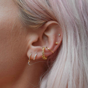 Mystic Moon Huggies in Gold worn with ear cuffs