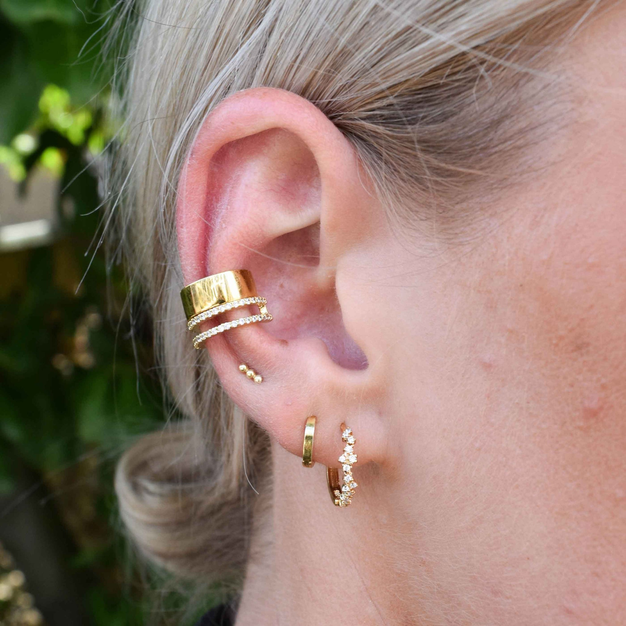 Mystic Simple Huggies in Gold worn in second lobe piercing