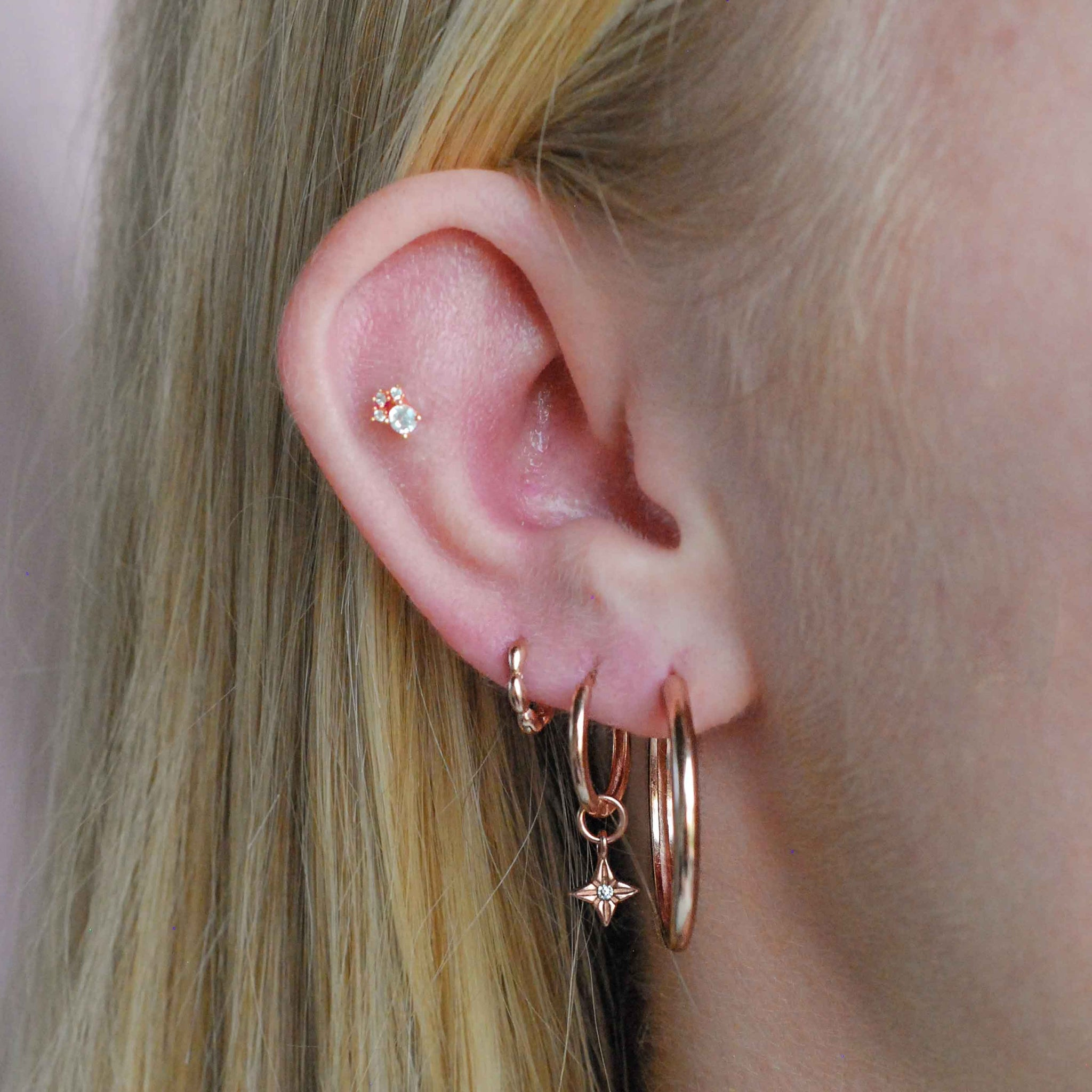 Simple Hinge Hoops in Rose Gold worn with hoops and clickers