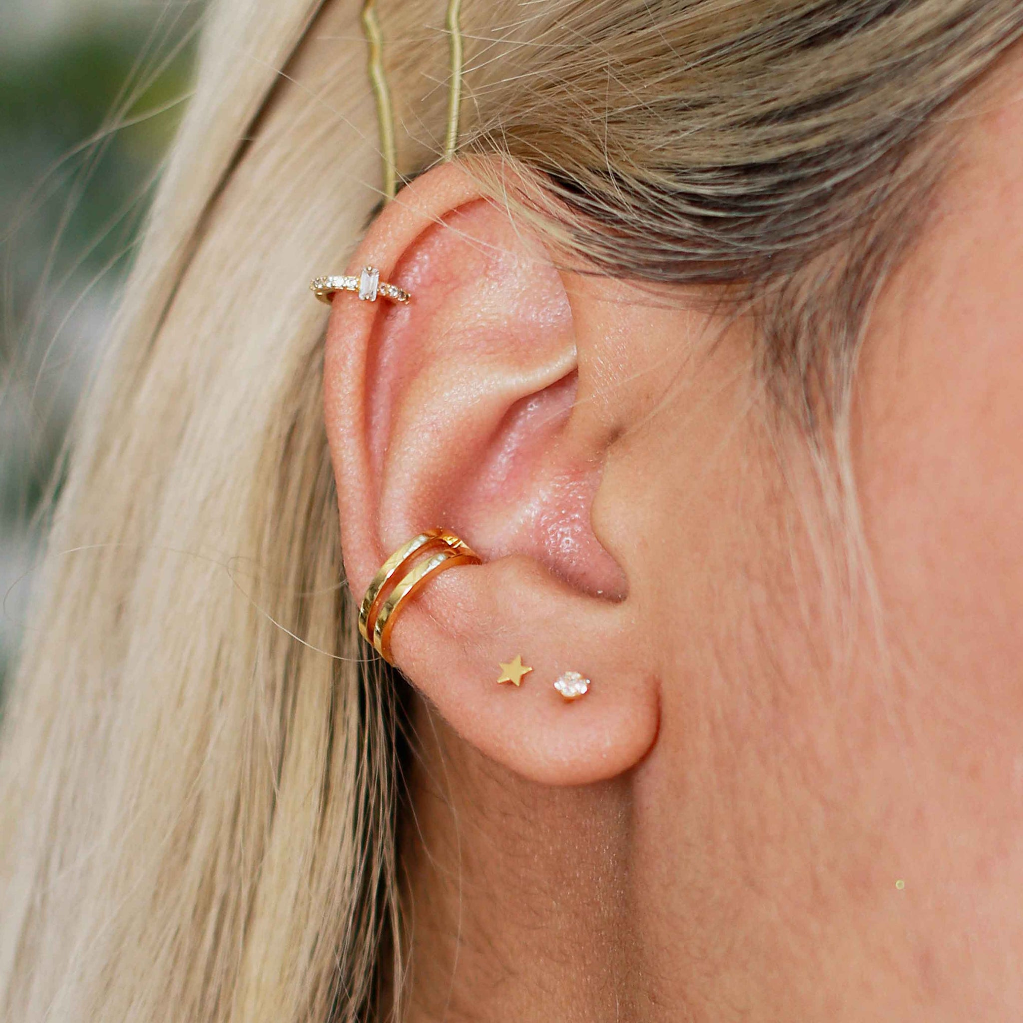 simple wish bone ear cuff in gold and ear stack, models ear