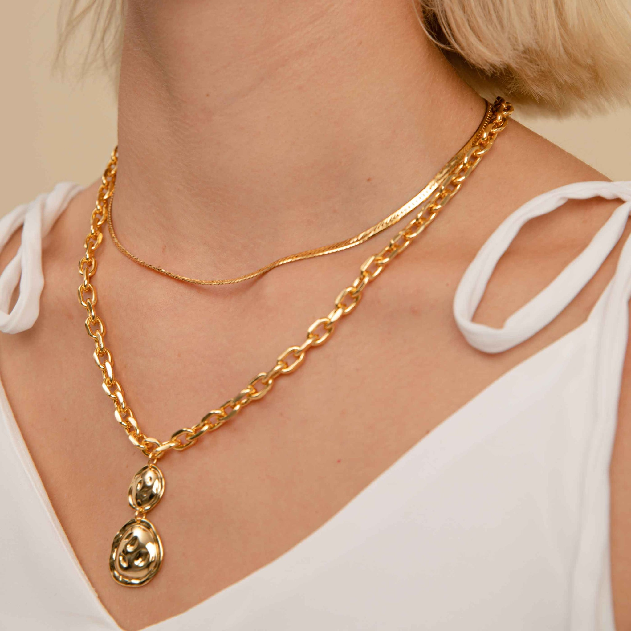 Snake Chain Necklace in Gold worn with chunky pendant necklace