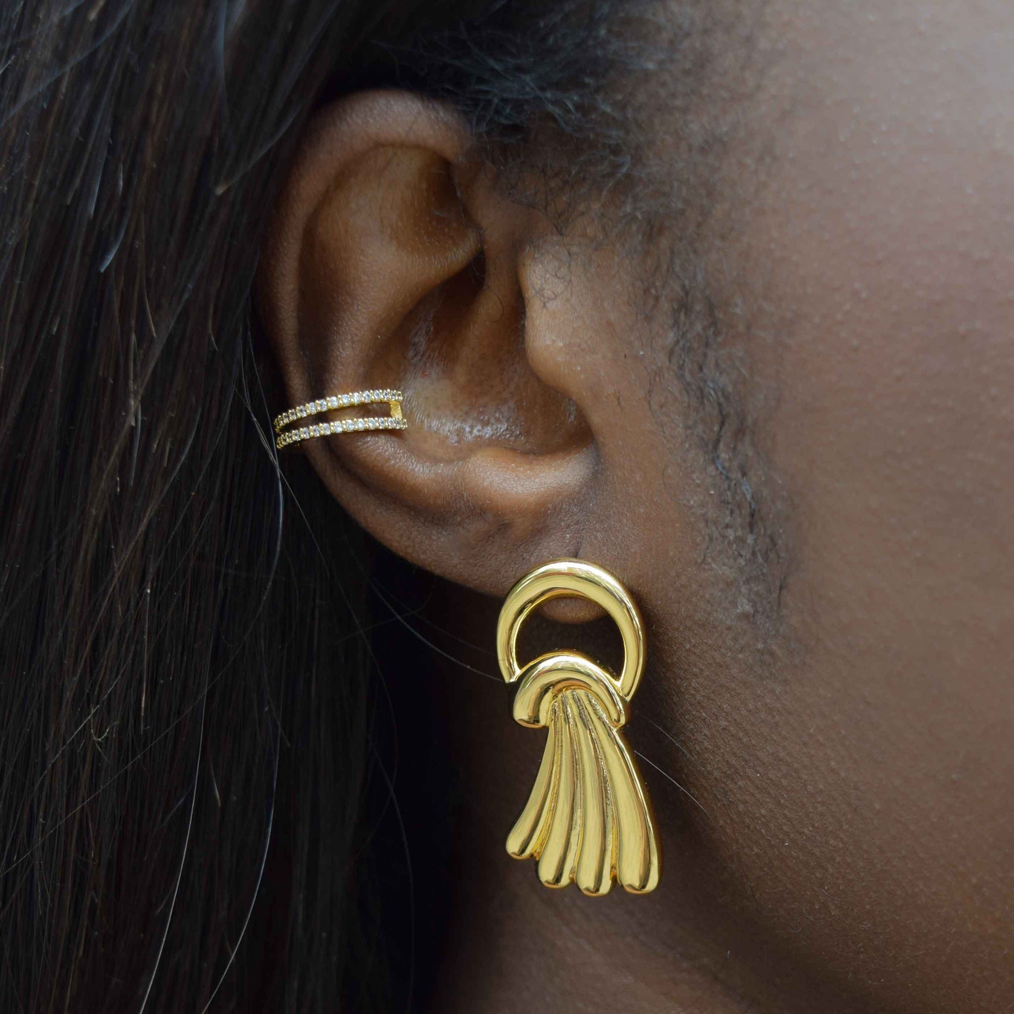 gold wishbone ear cuff on ear stack