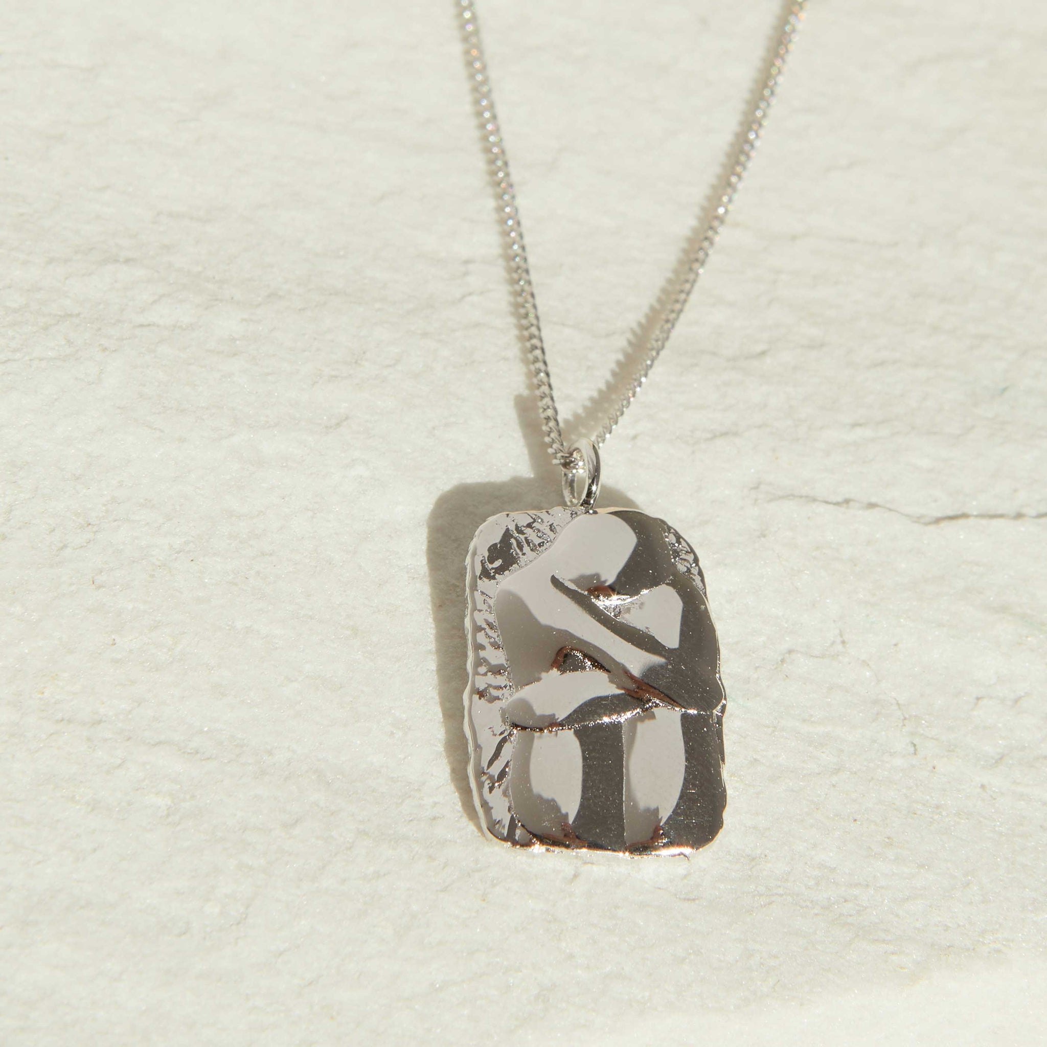 Embrace Pendant Necklace in Silver
