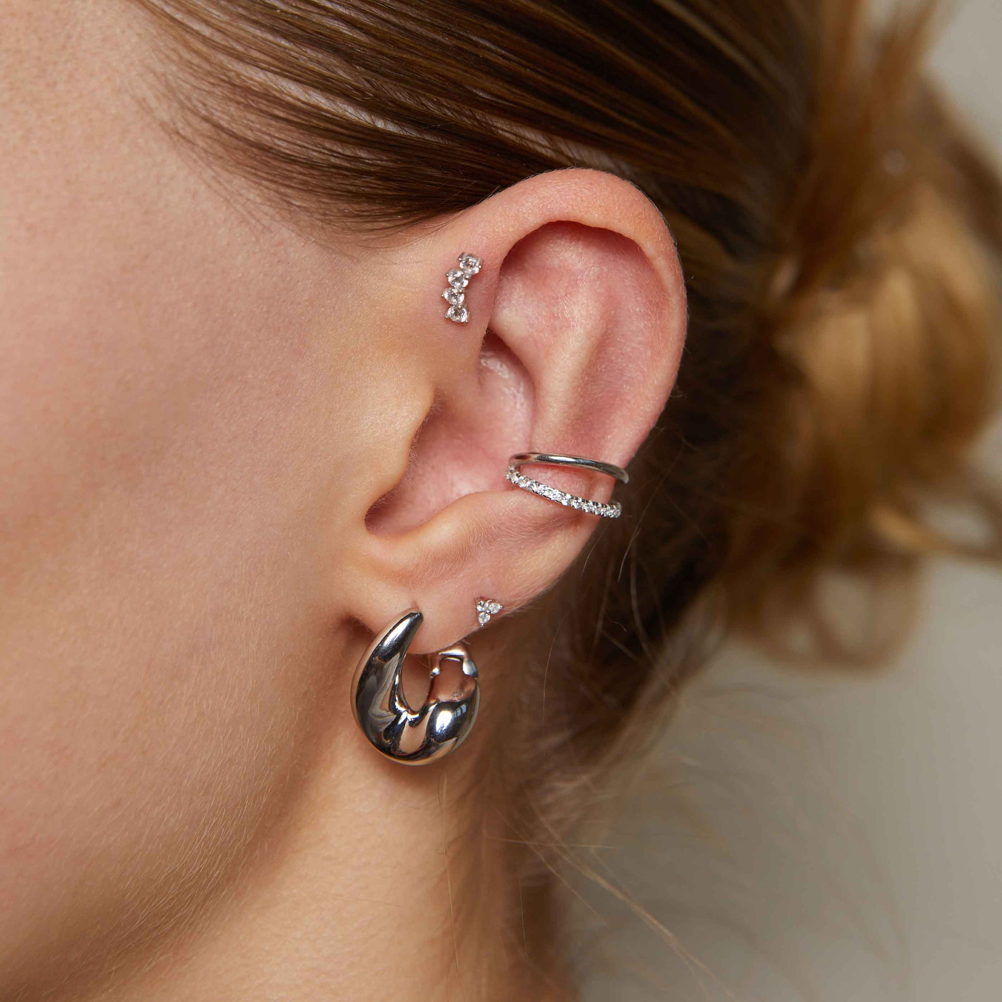 Illusion Crystal Ear Cuff in Silver worn with molten hoops and curved crystal barbell