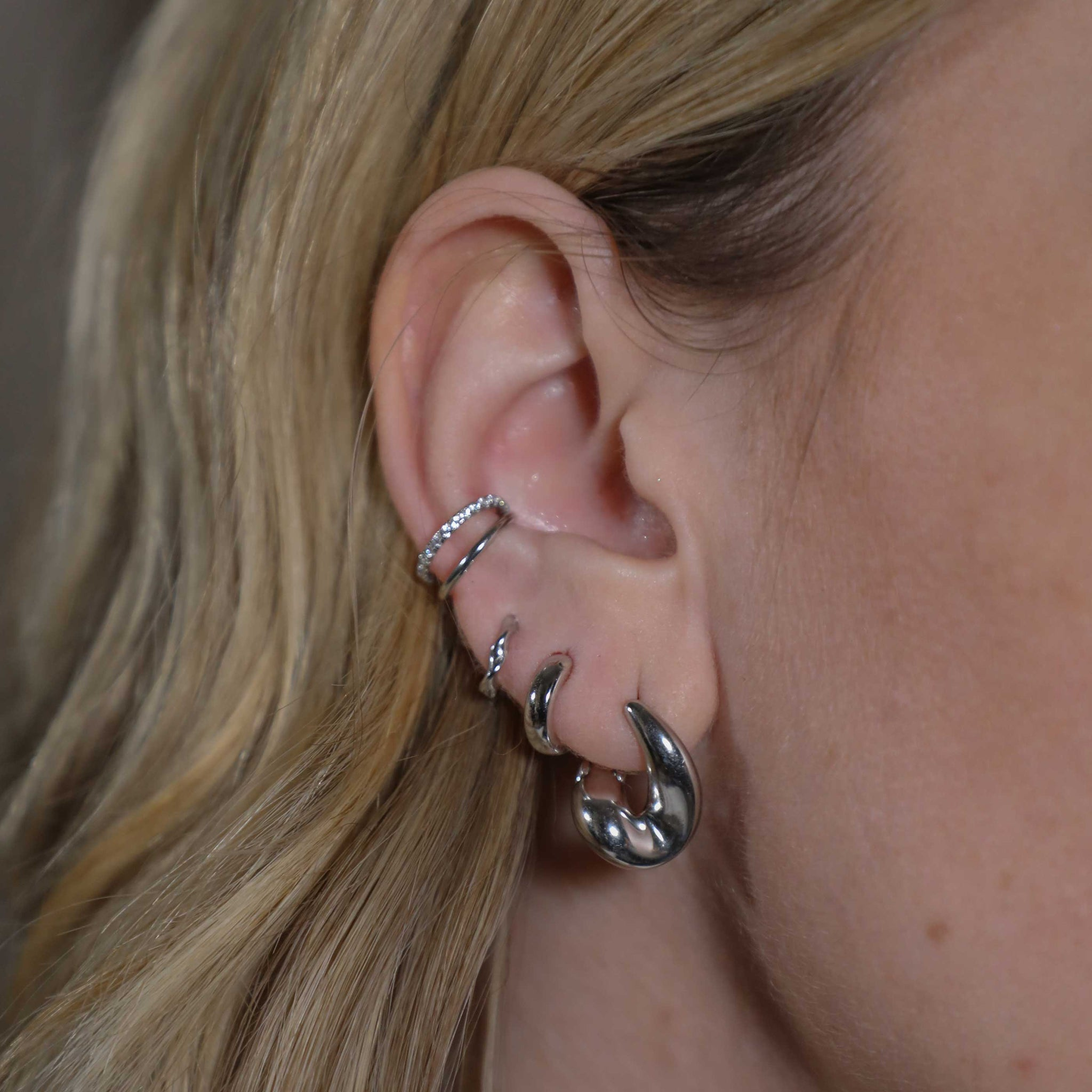Illusion Crystal Ear Cuff in Silver worn with elemental huggies and bold huggies
