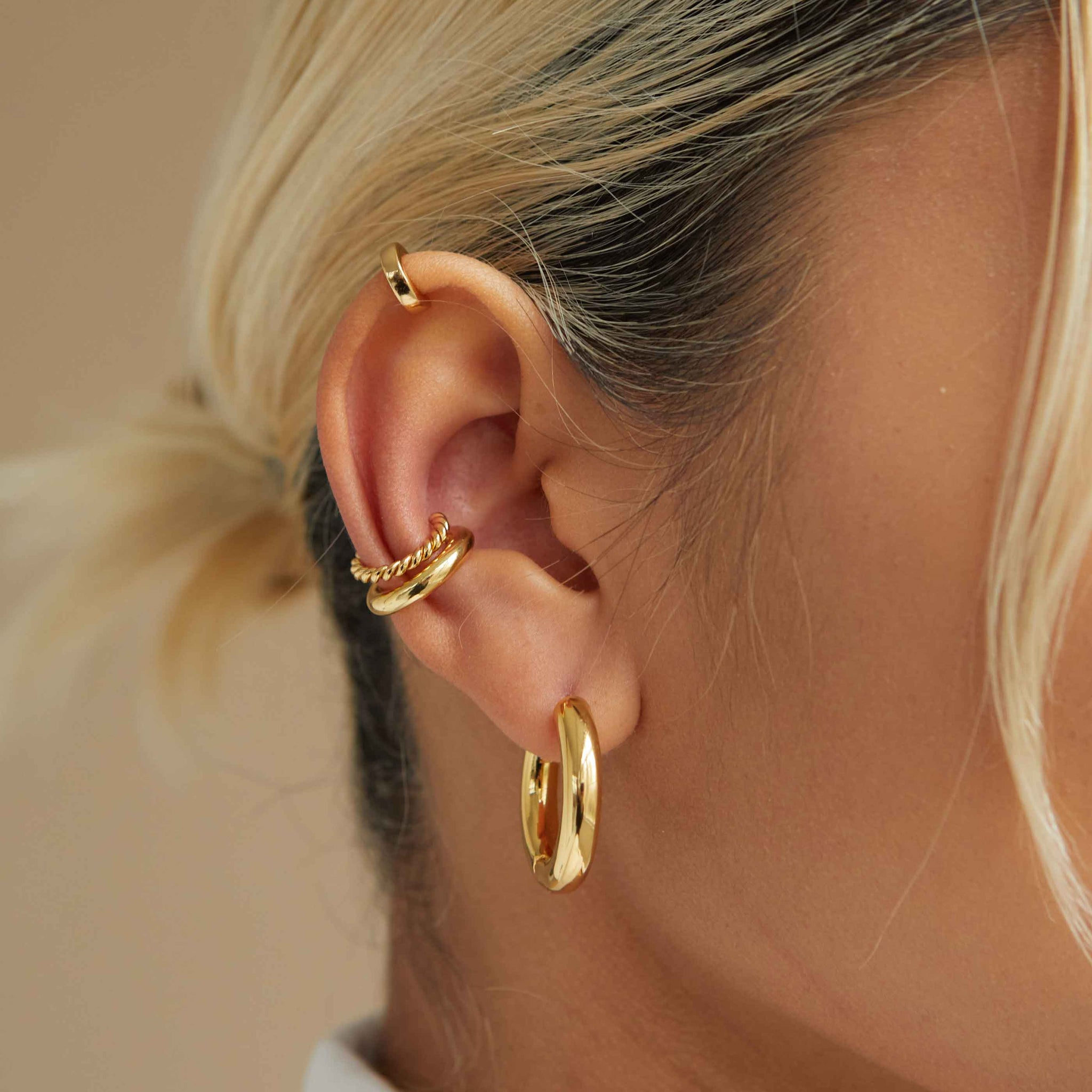 Mini Simple Wishbone Ear Cuff in Gold worn shot