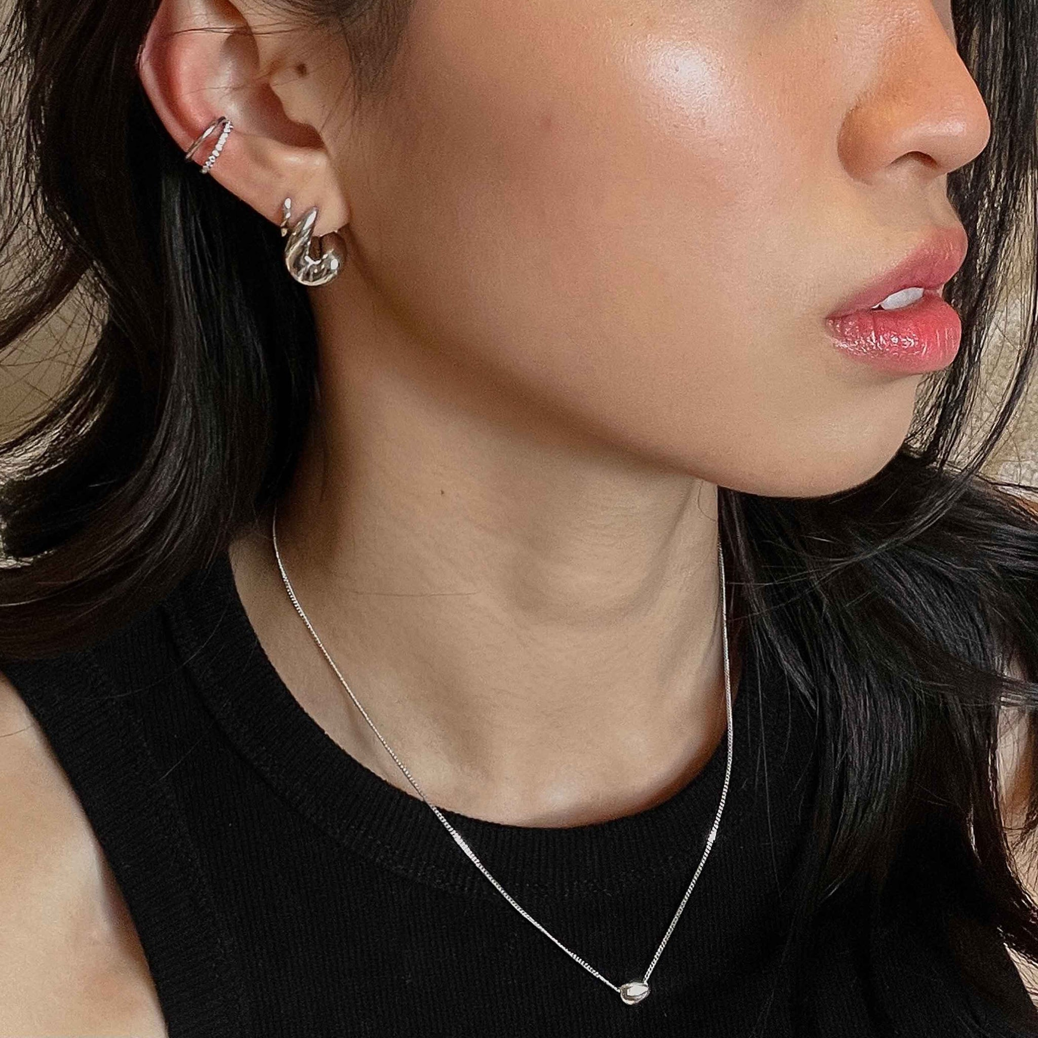 Illusion Crystal Ear Cuff in Silver worn with molten hoops and molten pendant necklace