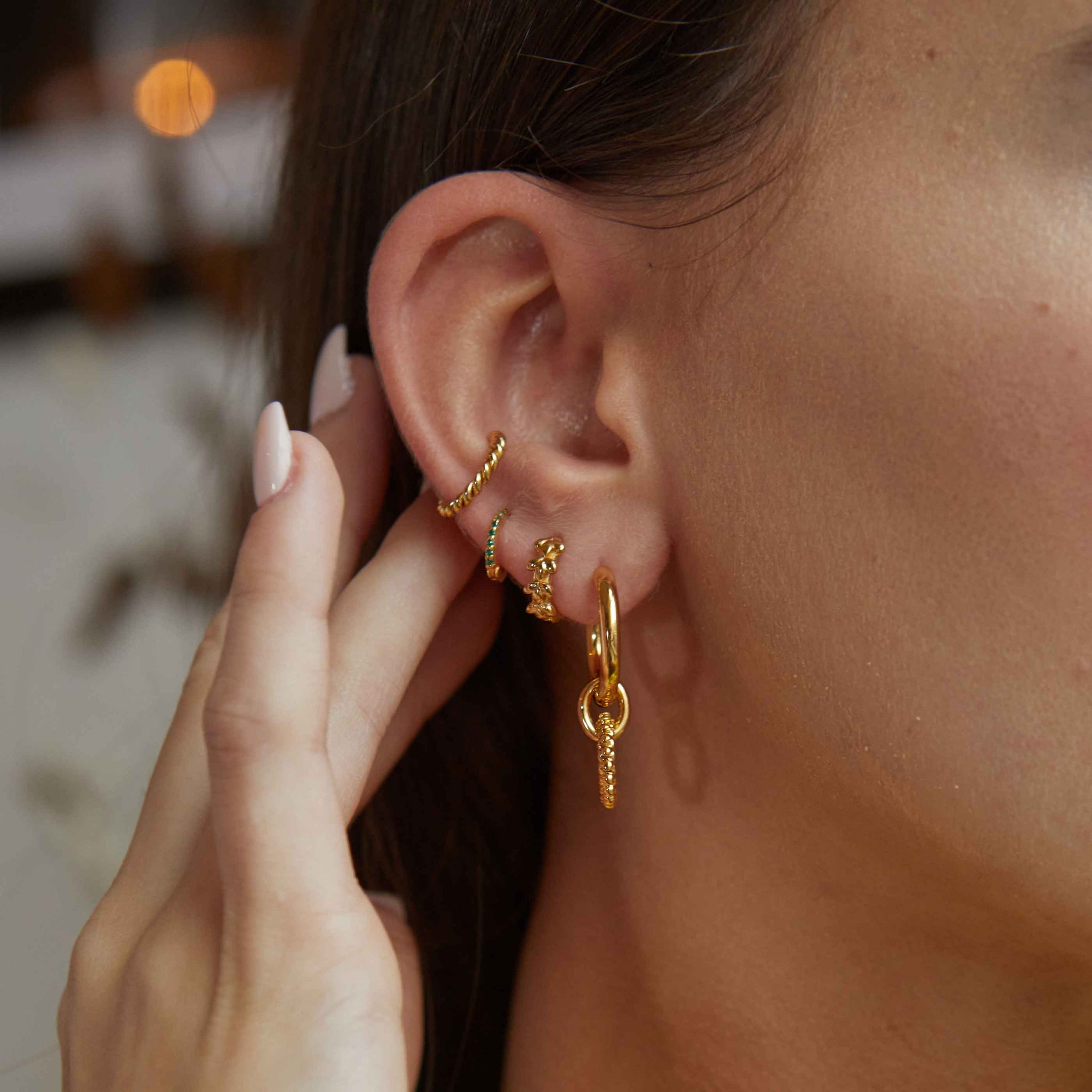 Rope Ear Cuff in Gold worn with huggies