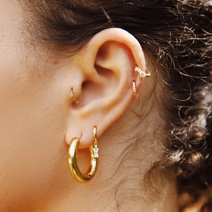 Triple Stone Huggies in Gold worn in helix piercing