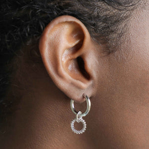 Wreath Charm Hoops in Silver worn\